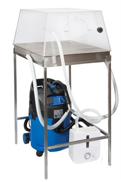 Suction table and humidity dome
